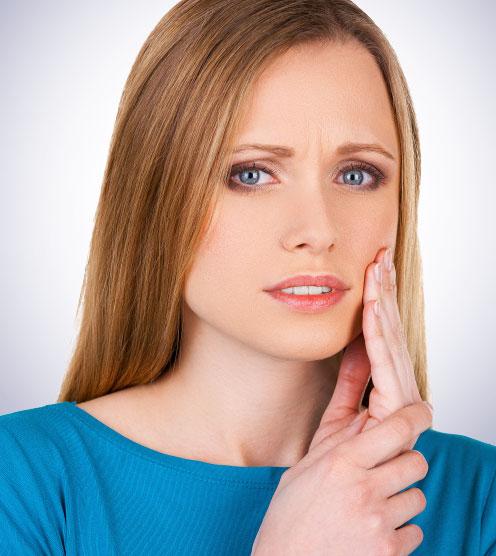 mujer con dolor-de-mandibula
